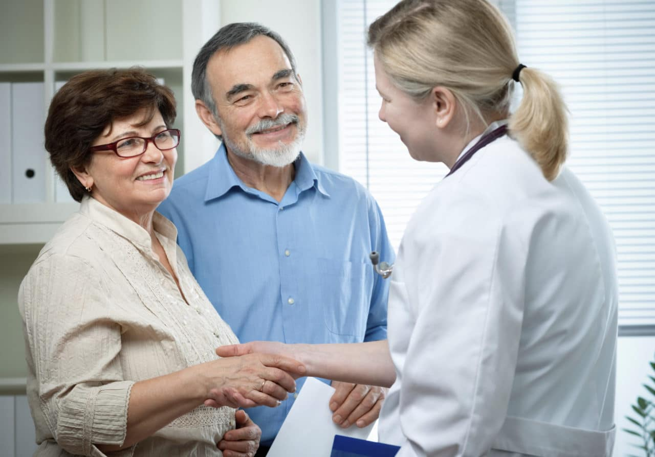A provider meeting an couple for consultation