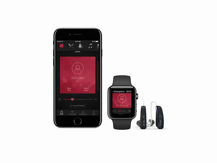 A photo of a smartphone and smart watch open to the ReSound Smart 3D app next to a pair of hearing devices